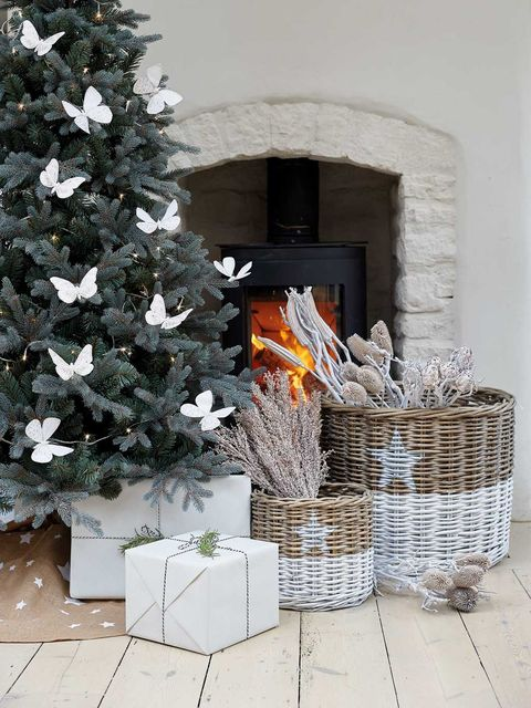 Christmas tree, Christmas decoration, Hearth, Tree, Fireplace, Wicker, Plant, Room, Home, Christmas stocking,