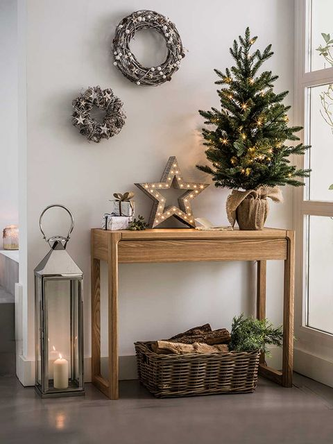 Christmas decoration, Furniture, Room, Shelf, Interior design, Christmas tree, Branch, Tree, Table, Material property,