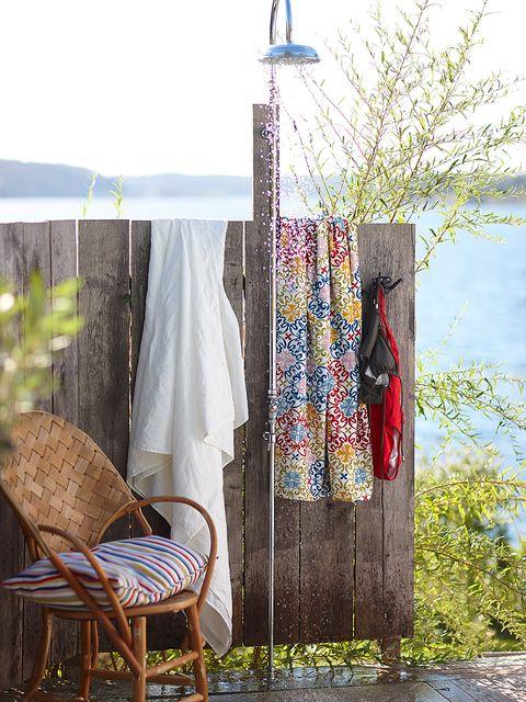 Chair, Door, Wicker, Outdoor furniture, Clothes hanger, Linens, Armrest, Rocking chair,