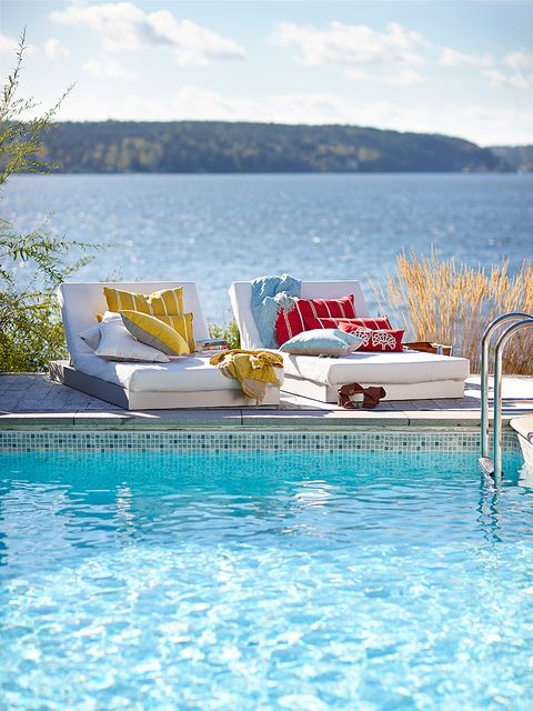 Swimming pool, Fluid, Water, Furniture, Outdoor furniture, Real estate, Resort, Azure, Aqua, Sunlounger,