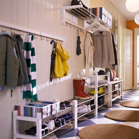Room, Clothes hanger, Interior design, Shelving, Door, Fedora, Outlet store, Shelf, Closet, Collection,