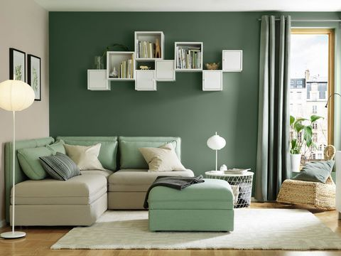 Furniture, Green, Room, Living room, Interior design, Wall, Turquoise, Couch, Brown, Shelf,