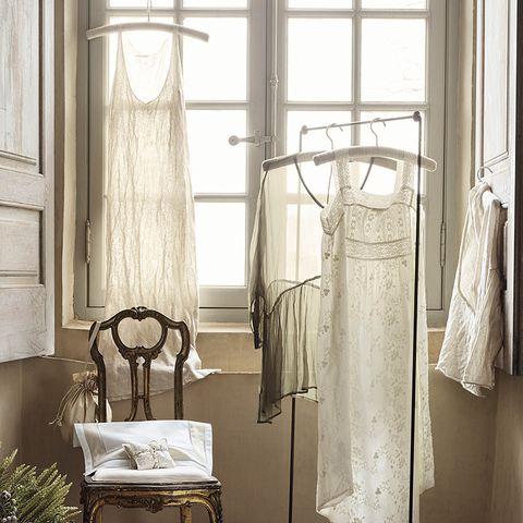 Textile, Interior design, Fixture, Clothes hanger, Window treatment, Home accessories, Iron, Bag, Interior design, Linens,