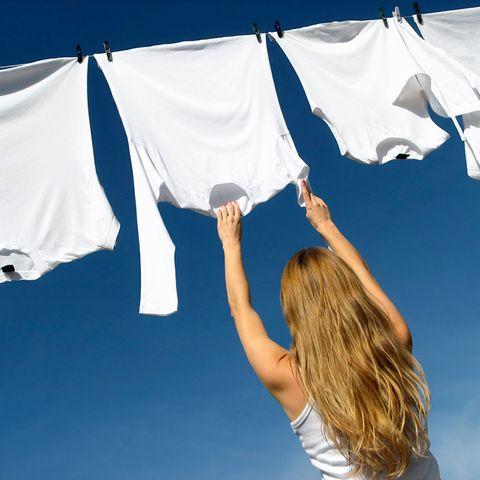 White, Blue, Sky, Flag, Textile, Electric blue, Cloud, Linens, Photography, Gesture,