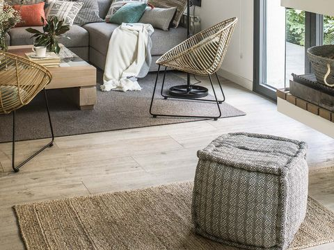 Floor, Flooring, Outdoor furniture, Grey, Wicker, Home, Coffee table, Interior design, Design, Home accessories,