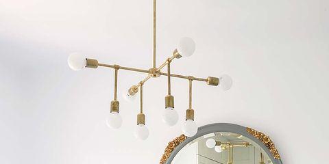 Room, Wall, Lighting, Ceiling, Brass, Mirror, Chandelier, Metal, Furniture, Light fixture,