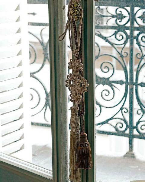 Iron, Metal, Fixture, Teal, Building material, Visual arts, Motif, Door handle, Handle,