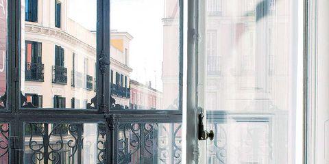 Glass, Room, Fixture, House, Home door, Door handle, Pillow, Material property, Throw pillow, Iron,