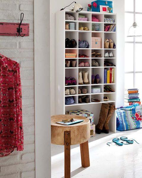 Room, Textile, Interior design, Wall, Shelving, Shelf, Pattern, Clothes hanger, Linens, Teal,