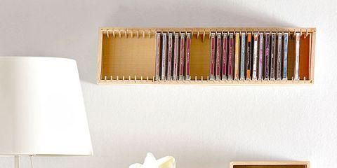Yellow, Room, Wall, Shelving, Petal, Interior design, Still life photography, Sideboard, Publication, Cut flowers,