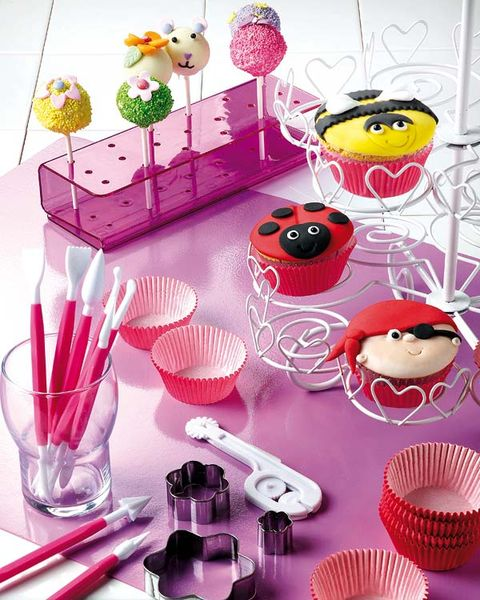 Pink, Party supply, Kitchen utensil, Flower Arranging, Baked goods, Dessert, Floral design, Cake, Artificial flower, Creative arts,