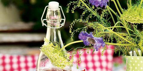Glass bottle, Bottle, Party supply, Serveware, Lavender, Home accessories, Linens, Sweetness, Present, Dessert,