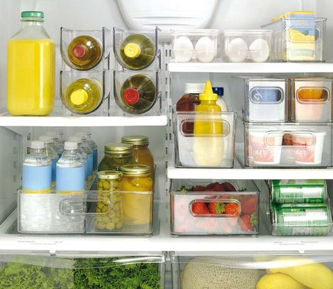 Fluid, Liquid, Yellow, Bottle, Major appliance, Food storage containers, Freezer, Kitchen appliance, Fruit, Home appliance,
