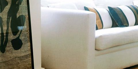 Wood, Floor, Flooring, Interior design, Wood flooring, Laminate flooring, Couch, Wall, Hardwood, Living room,