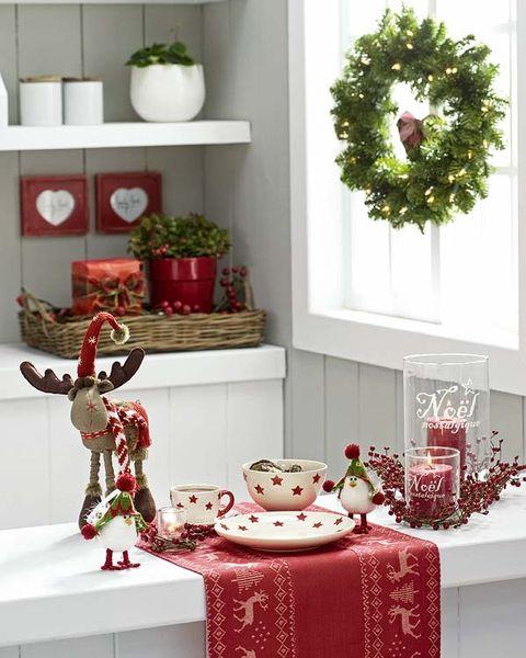 Christmas decoration, Red, Room, Christmas, Interior design, Furniture, Table, Christmas ornament, Christmas tree, Textile,