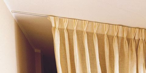 Textile, Room, Interior design, Wall, Window covering, Window treatment, Linens, Tan, Tints and shades, Beige,