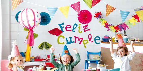 Room, Party supply, Table, Balloon, Interior design, Furniture, Pink, Child, Sharing, Sitting,