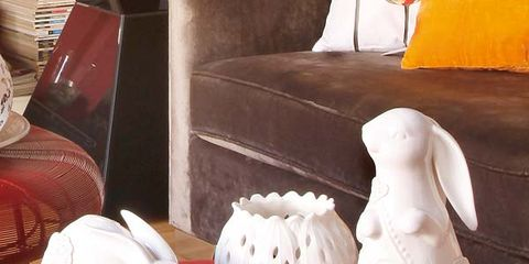 Porcelain, Living room, Interior design, Ceramic, Couch, Toy, Rabbits and Hares, Artifact, Club chair, Home accessories,