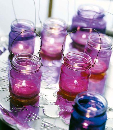 frascos de yogur tintados con velas