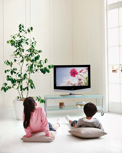 Human, Human body, Display device, Room, Television set, Wall, Interior design, Sitting, Flat panel display, Fixture,
