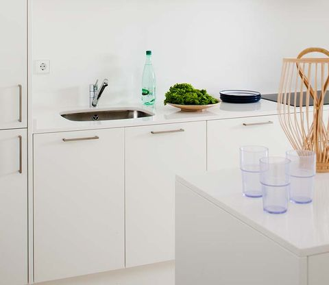 White, Furniture, Room, Table, Kitchen, Interior design, Countertop, Shelf, Line, Material property,
