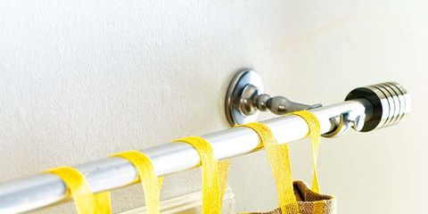Yellow, Amber, Household supply, Clothes hanger, Shower head, Household cleaning supply, Brass,