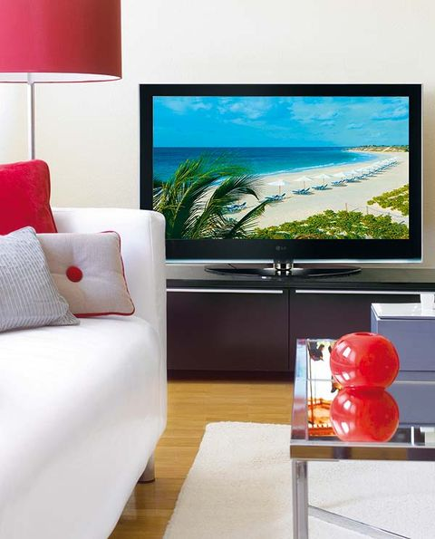 Display device, Interior design, Room, Flat panel display, Red, Living room, Television set, Wall, Pillow, Interior design,