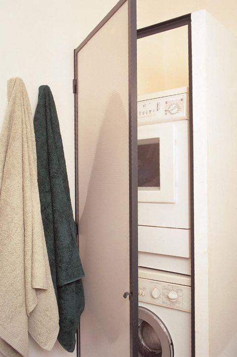 Fixture, Major appliance, Grey, Towel, Washing machine, Clothes dryer, Door handle, Door, Laundry room, Home appliance,