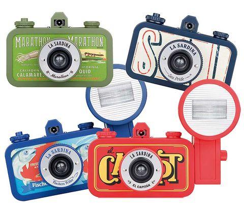 Electronic device, Cameras & optics, Lens, Film camera, Technology, Digital camera, Font, Camera accessory, Camera lens, Circle,