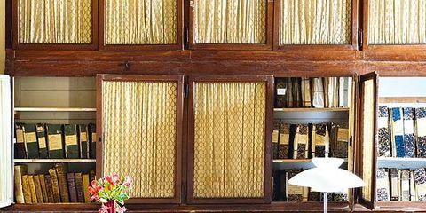 Room, Lighting, Interior design, Furniture, Shelf, Office chair, Table, Shelving, Floor, Flooring,