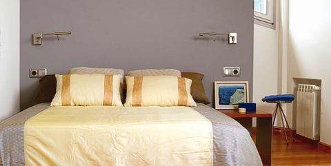 dormitorio con murete a media altura