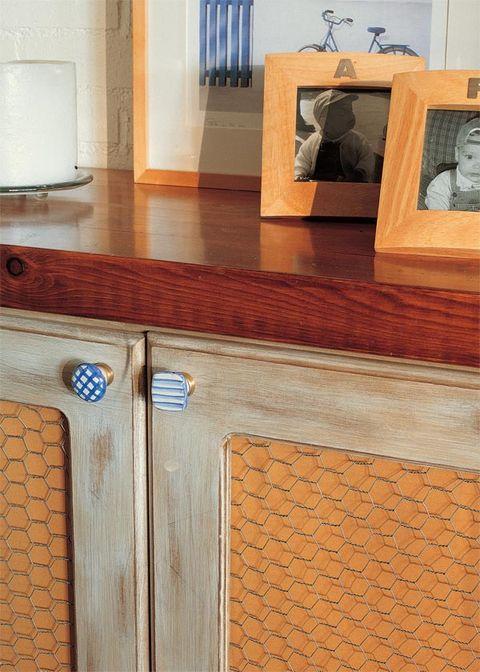 Wood, Floor, Flooring, Hardwood, Wood stain, Tan, Picture frame, Varnish, Door handle, Handle,