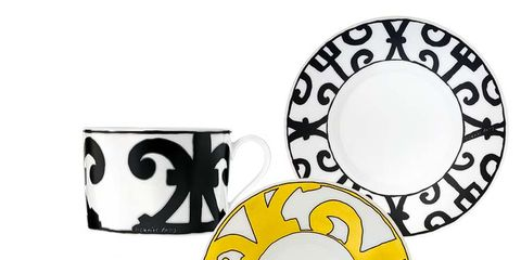 Yellow, Font, Circle, Cup, Symbol, Number,