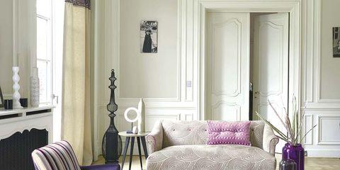 Room, Interior design, Home, Living room, Floor, Furniture, Purple, Flooring, Wall, Table,
