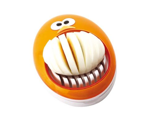 Orange, Amber, Fictional character, Tooth, Animated cartoon, Graphics, Baked goods, Moustache,