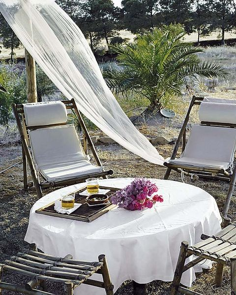 Tablecloth, Textile, Furniture, Table, Outdoor furniture, Linens, Home accessories, Outdoor table, Shade, Centrepiece,