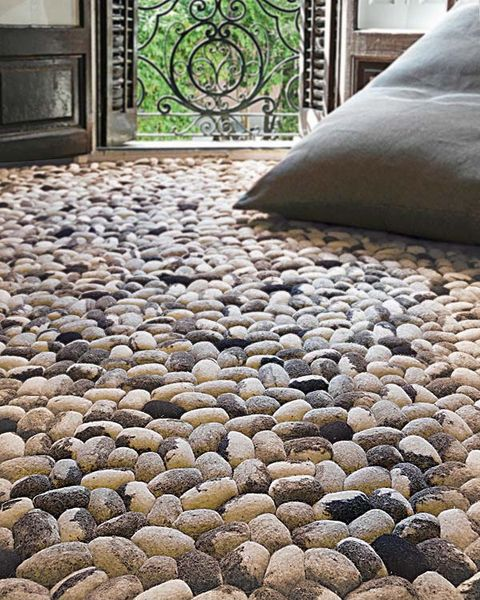 Flooring, Floor, Linens, Bedding, Natural material, Circle, Pebble, Bed sheet, Pillow, Home accessories,