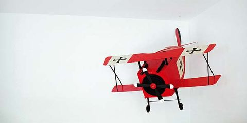 Helicopter, Room, Interior design, Red, Rotorcraft, White, Wall, Aircraft, Living room, Furniture,
