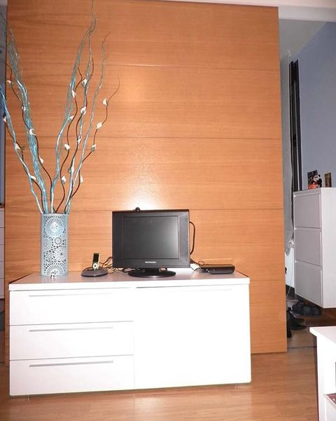 Wood, Room, Display device, Interior design, Electronic device, Flat panel display, Wall, Twig, Television set, Cabinetry,