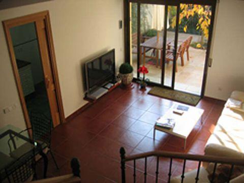 Wood, Floor, Room, Property, Flooring, Interior design, Home, Hardwood, Television set, House,
