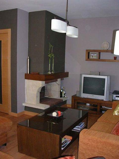 Wood, Room, Interior design, Display device, Living room, Wall, Hardwood, Television set, Wood stain, Interior design,