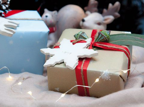 Gift wrapping, Carmine, Present, Ribbon, Party supply, Rabbits and Hares, Ingredient, Rabbit, Confectionery, Dessert,