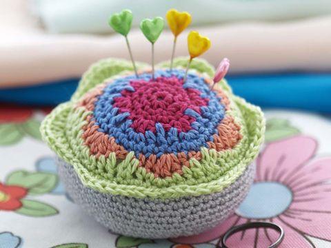 Textile, Pink, Pattern, Crochet, Petal, Magenta, Creative arts, Craft, Woolen, Knitting,