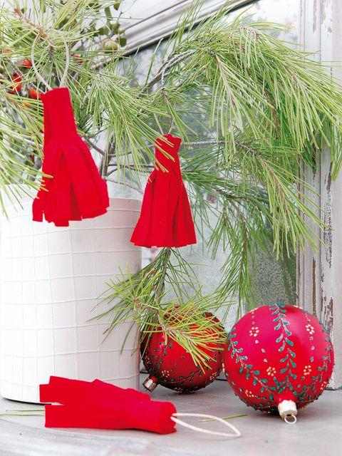 Christmas decoration, Red, Christmas ornament, Carmine, Christmas, Holiday, Holiday ornament, Interior design, Costume accessory, Ornament,
