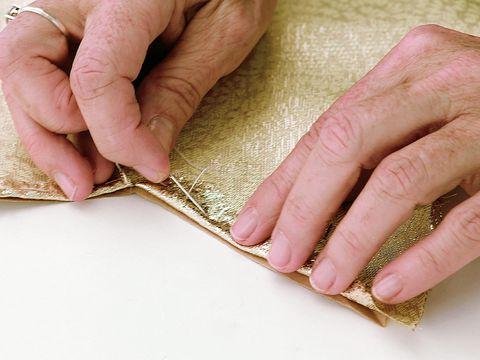 Finger, Skin, Nail, Wrist, Tan, Beige, Metal, Material property, Thumb, Kitchen utensil,
