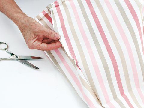 Finger, Wrist, Pink, Pliers, Pattern, Office supplies, Beige, Snips, Metalworking hand tool, Office instrument,
