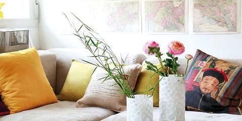 Room, Interior design, Furniture, Couch, Interior design, Table, Petal, Living room, Home, Vase,