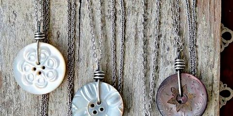 Earrings, Natural material, Metal, Circle, Silver, Body jewelry, Craft,