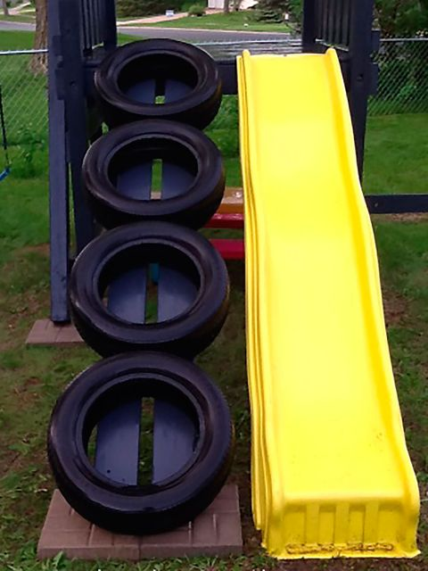 Grass, Yellow, Green, Public space, Purple, Outdoor play equipment, Playground slide, Chute, Human settlement, Plastic,