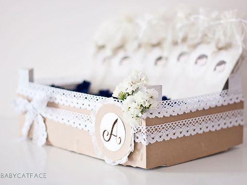 Petal, Beige, Floral design, Rectangle, Cut flowers, Natural material, Wedding favors, Creative arts, Present, Strap,